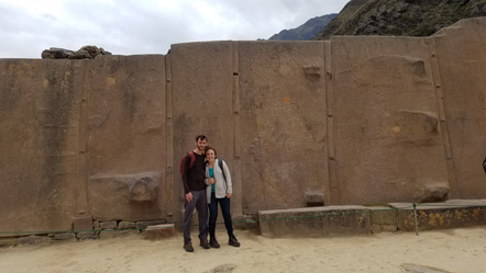 Emily and I in front of  the Wall of the Six Monoliths. There is the beginning of an Incan cross to our right.