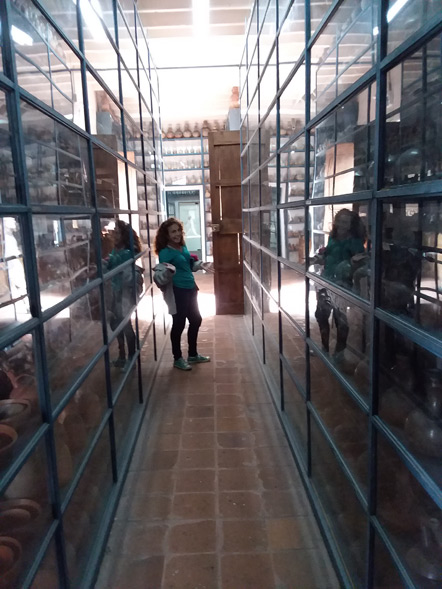 Emily exploring the Museo Larco's pottery storage.