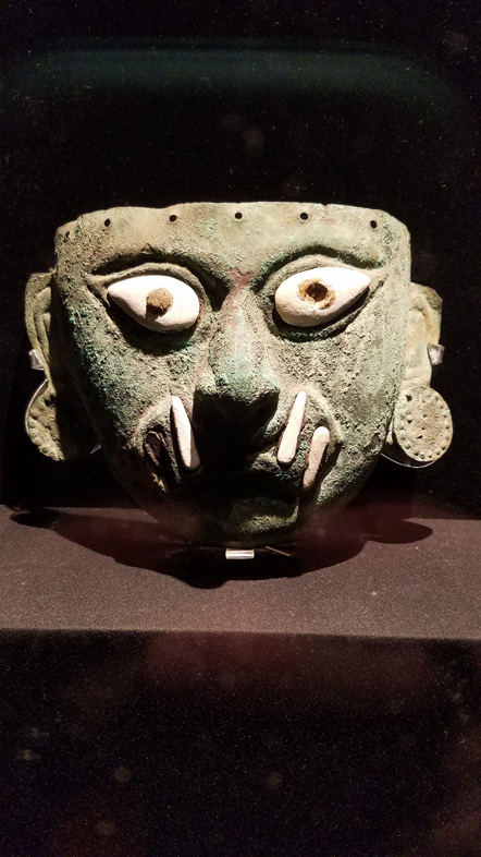 A Mochican copper burial mask.