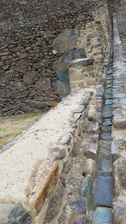 The terraces have an irrigation system. There are holes in the wall were you can divert the water flow into the terrace.
