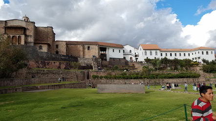 The Qorikancha. The black stones on the left are an original Incan wall with the Dominican church behind it. The white buildings to the right make up the monastery.